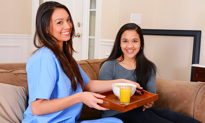 a caregiver serving snacks to a patient