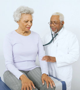 a doctor checking the blood pressure of a senior woman