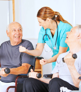 a physical therapist assisting two senior men use weights