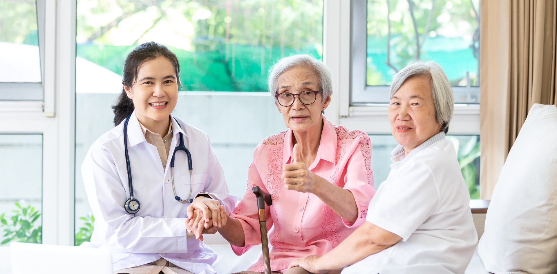 a doctor checking the health of two seniors