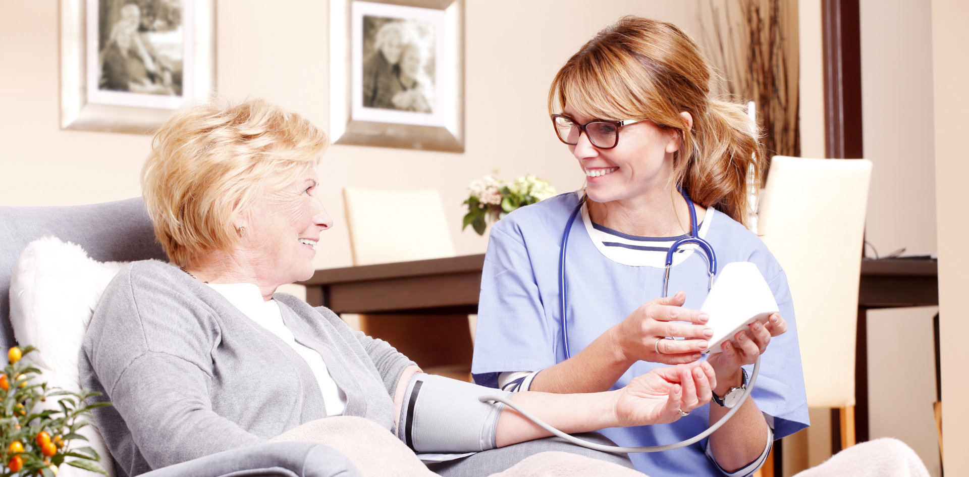 a nurse checking the blood pressure of a senior woman