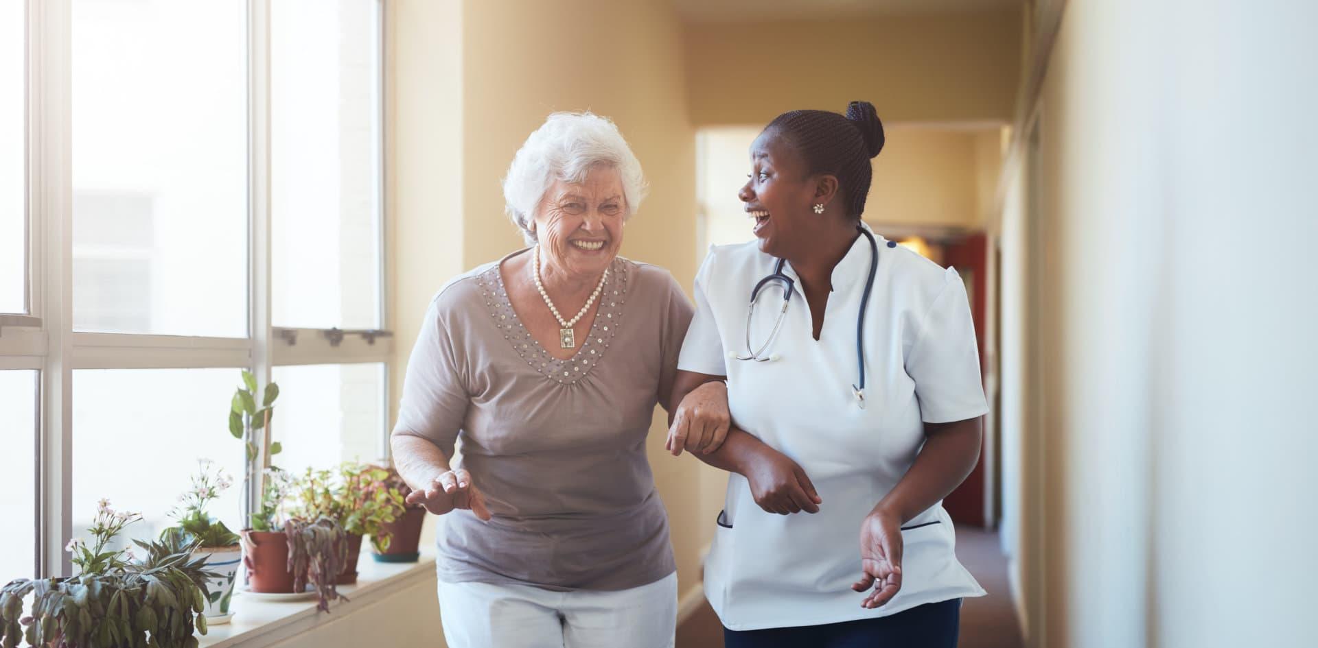 a nurse and a senior woman talking
